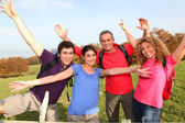 Group of friends hiking in countryside — Stock Photo