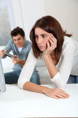Young woman fed up with boyfriend playing video game — Stock Photo