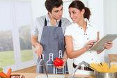 Couple in kitchen — Stock Photo