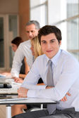 Portrait of businessman in the office — Stockfoto