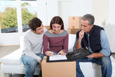 Young couple signing contract for home moving — Stok fotoğraf