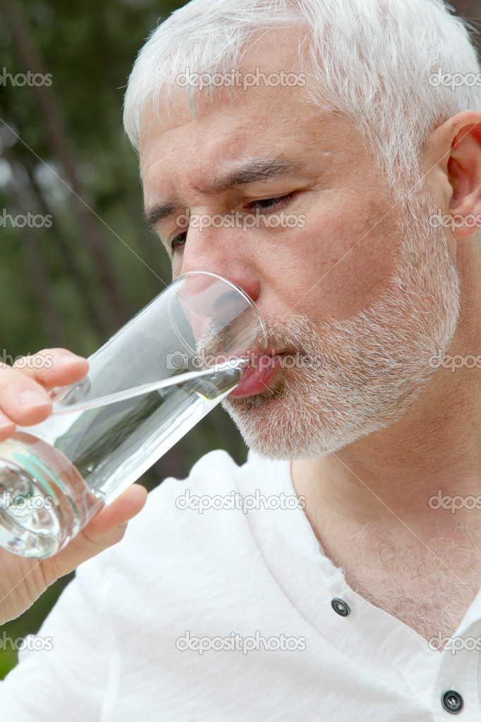 Senior man drinking fresh water — Stock Photo #5695409