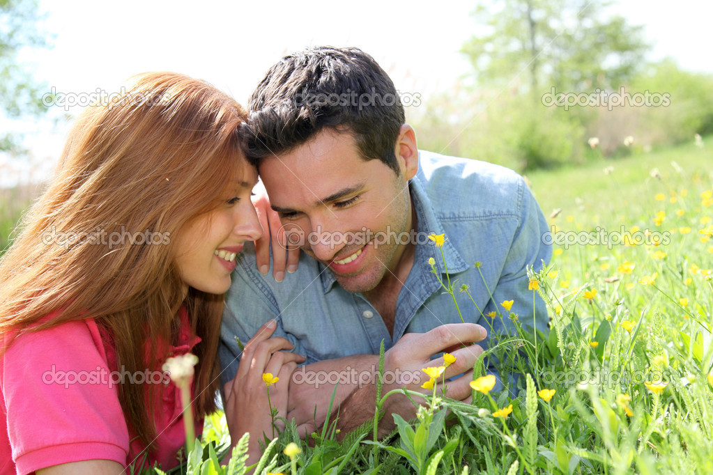 Couple of lovers laying donw in park  Stock Photo #5696096