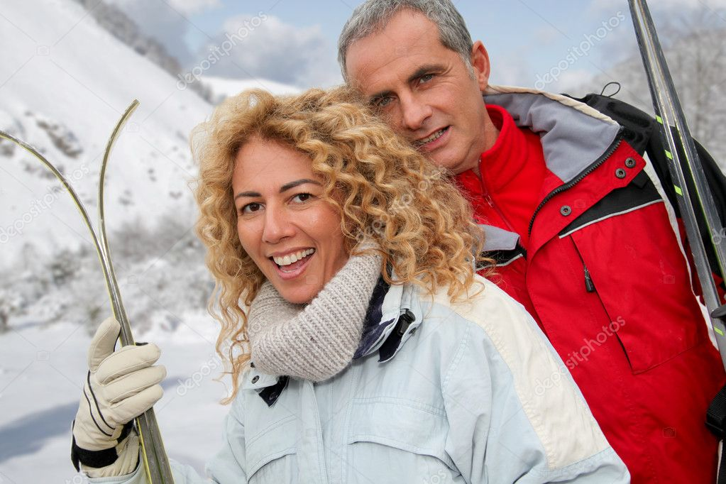 Happy couple at ski resort  Stock Photo #5697349