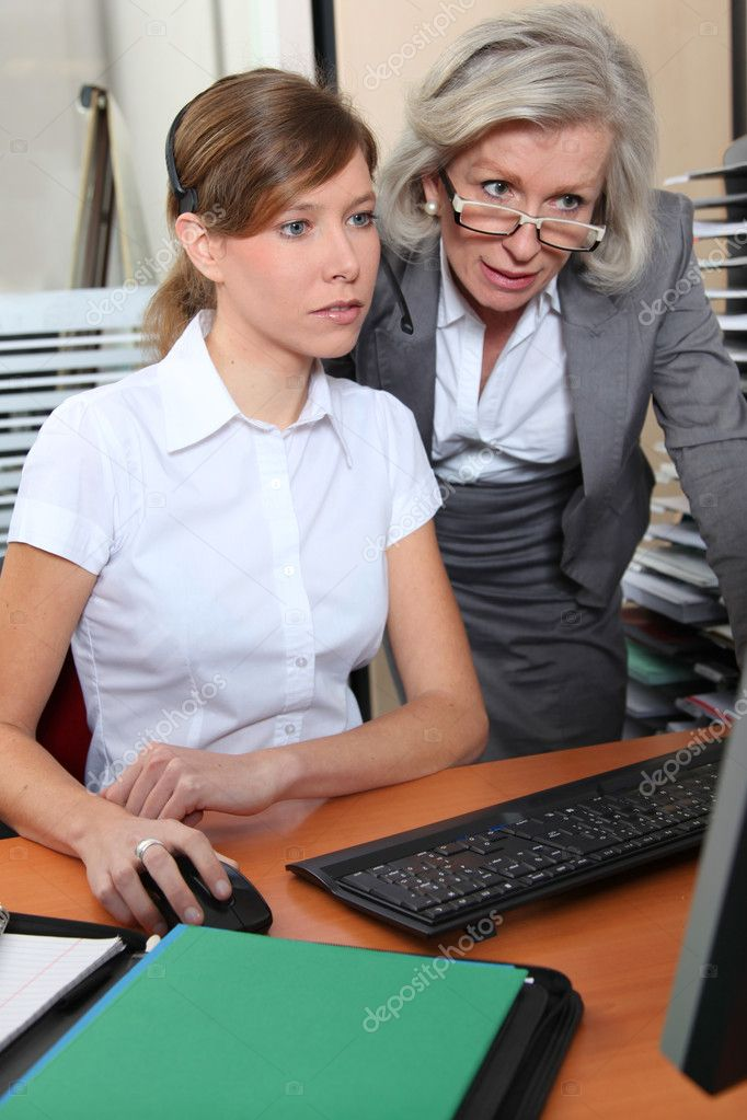 Senior businesswoman in office with young woman  — Stock Photo #5698132