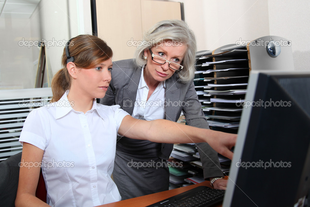 Senior businesswoman in office with young woman  — Stock Photo #5698133