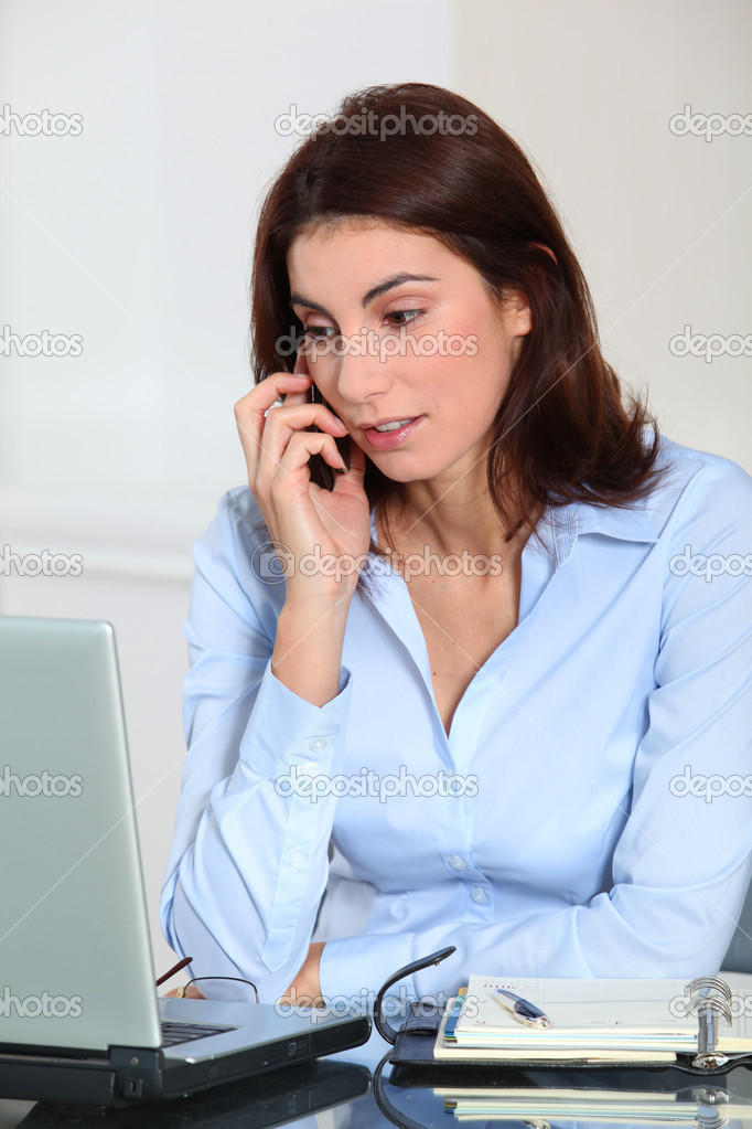 Portrait of businesswoman on the phone  Stock Photo #5698249