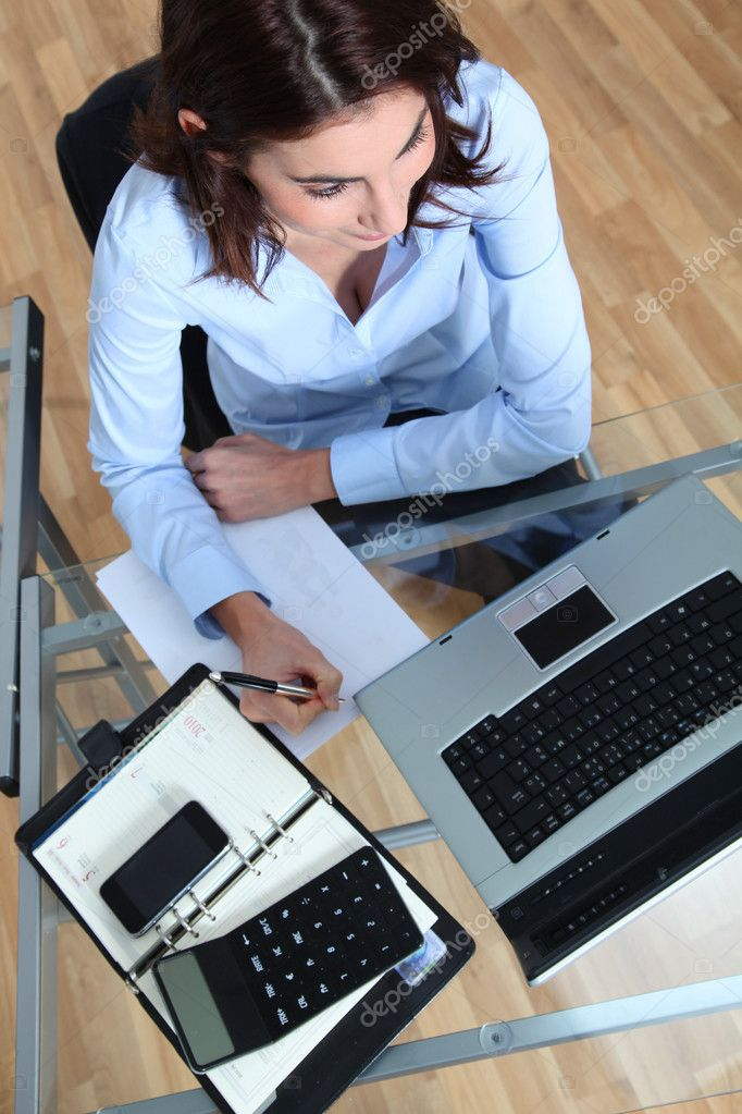 Businesswoman sitting in front of laptop computer  Stock Photo #5698345