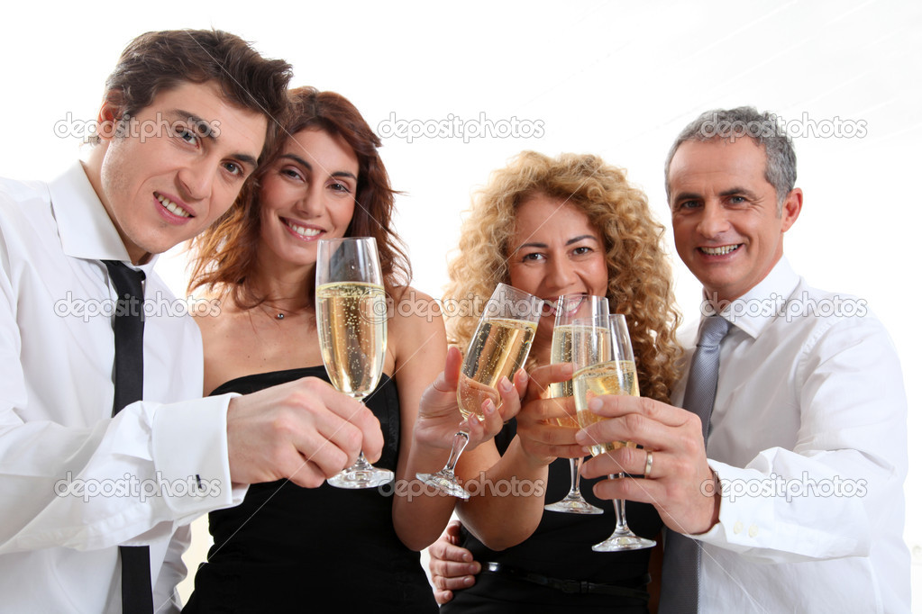 Group of friends cheering with glasses of champagne  Stock Photo #5699005