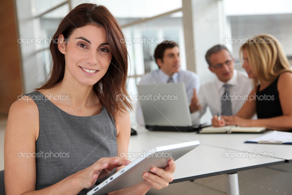 Executive woman working on electronic tab — Stock Photo #5699486