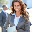 Stock Photo: Portrait of beautiful smiling businesswoman