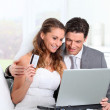 Bride and groom doing shopping on inernet — Stock Photo #5700318