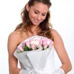Beautiful bride holding flowers bouquet — Stock Photo #5700359