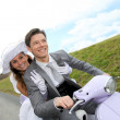 Married couple riding motorcycle — Lizenzfreies Foto