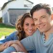Portrait of happy new property owners - Stock Photo