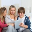 Family having fun at home using electronic tablet - Stock Photo