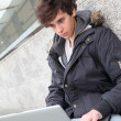 Student with laptop computer - Stock Photo