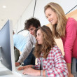 Students in training course looking at desktop computer — Stock Photo #5701111