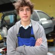 Portrait of teenager in mechanics apprenticeship — ストック写真
