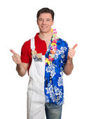 Home painter and man in hawaiian shirt with thumbs up — Stock Photo