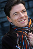 Portrait of handsome man wearing scarf — Stock Photo