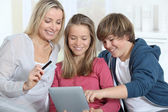 Mother and children doing online shopping — Stock Photo