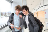 Teenage boys using electronic tablet — Stock Photo