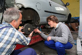 Teenager in professional training in workshop — Stock Photo