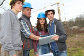 Adult with group of teenagers in professional training — Stock Photo