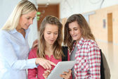 Teacher and teenage girls — Stock Photo