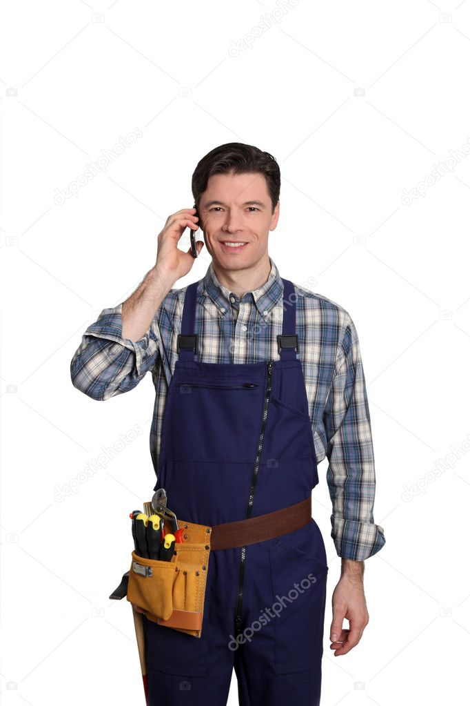 Carpenter standing on white background with mobile phone — Stock Photo #5700114