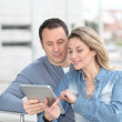 Couple using electronic tab in the street — Stock Photo #6697878