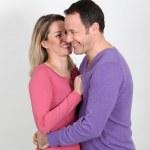 Woman whispering to her boyfriend's ear — Stock Photo #6697955