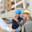 Royalty-Free Stock Photo: Architect and engineer looking at plan on construction site
