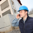 Supervisor talking on the phone on construction site — Stock Photo