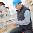 Supervisor using electronic tab on construction site — Stock Photo