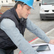 Stock Photo: Engineer on construction site with electronic tab