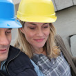 Closeup of architects with security helmets — Stock Photo #6698065