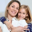 Portrait of happy mother and little girl — Stock Photo