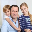 Portrait of father and children at home — Stock Photo