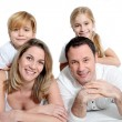 Happy family laying on bed — Stock Photo #6698186