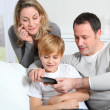 Family playing video game on smartphone — Stock Photo