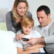 family playing video game on smartphone — Stock Photo #6698250