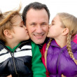 Kids giving a kiss to their daddy — Stock Photo