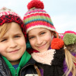 Brother and sister portrait in winter time — Stockfoto