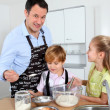 Father and children preparing pancakes — Stock Photo #6698514