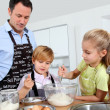Royalty-Free Stock Photo: Father and children preparing pancakes