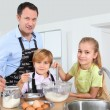Father and children preparing pancakes — Stock Photo #6698516