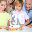 Family celebrating child's birthday — Stock Photo