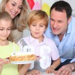 Family celebrating child's birthday - Stock Photo